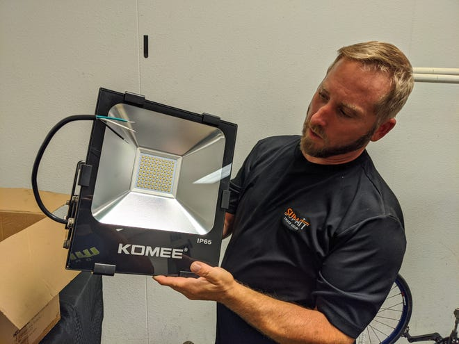 Rick Johnson holds a donated light from KOMEE that the Wee-Chi-Tah BMX wants to install at the track to allow operations at night.