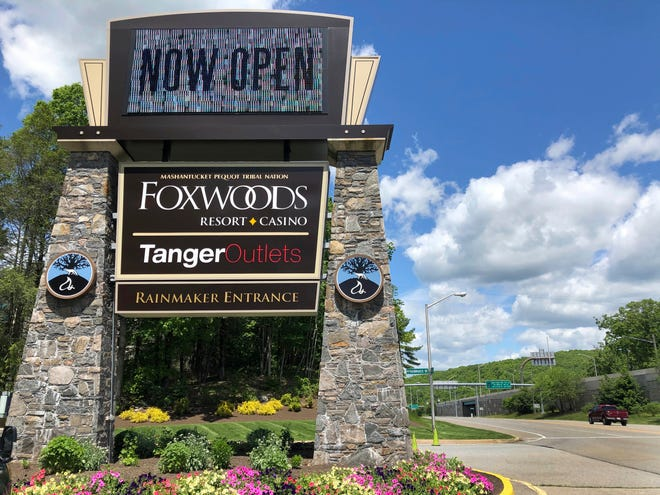 A sign at the entrance to the Foxwoods Resort Casino in Mashantucket, Conn., announces its reopening on June 1. Both tribal casinos, Foxwoods and Mohegan Sun, closed since March 17, opened despite opposition from Connecticut Gov. Ned Lamont, who has limited power regarding the sovereign nations.
