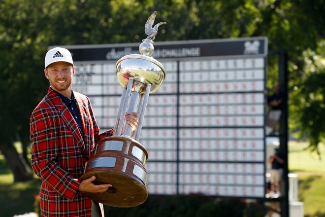 Daniel Berger celebrates winning the Charles Schwab Challenge golf tournament at Colonial Country Club.