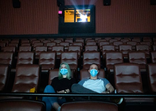 Kayleigh Tansey and Justin Smith take in a movie on May 4 at EVO Entertainment in Kyle, Texas. As more states relax measures, expect to see masks and social distancing when theaters begin national reopening measures.