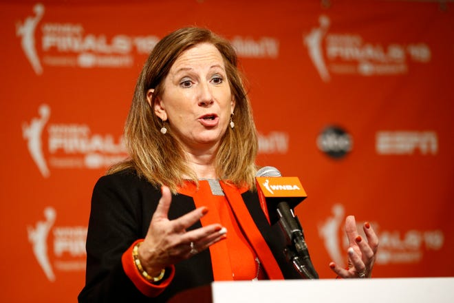 WNBA Commissioner Cathy Engelbert announced plans to play a reduced season, with a 22-game schedule that would begin in late July without fans in attendance in Florida. PATRICK SEMANSKY/AP