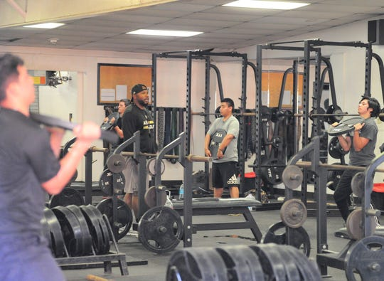 Abilene High football players participate in a workout Monday in the campus weight room during a strength and conditioning session.