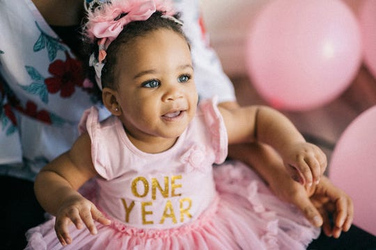 A one year-old celebrates her first birthday.
