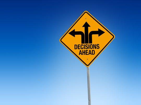 Descisions ahead road sign