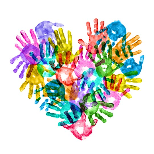 Colorful children's hand print forming a heart shape.
