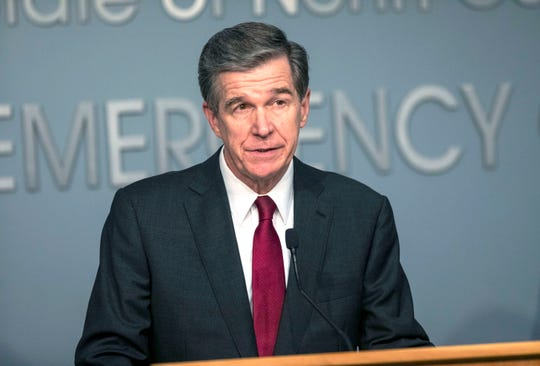 Gov. Roy Cooper delivers a briefing on North Carolina's coronavirus pandemic response Monday, Jun. 15, 2020, at the N.C. Emergency Operations Center in Raleigh, N.C.  (Casey Toth/The News & Observer via AP)