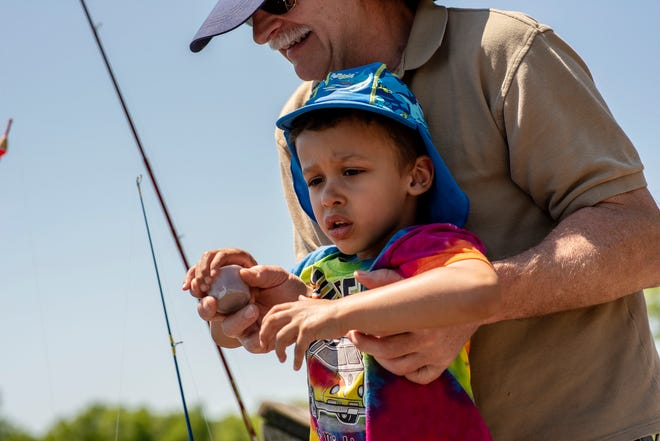 Pete Adamski from Comstock takes his grandson Sebastian Irving, 4, fishing on Whitford Lake Monday, June 15, 2020 at Fort Custer Recreational Area in Augusta, Mich.