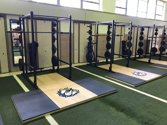 Eight lifting platforms line the sides of the facility, three on one side, five on the other.