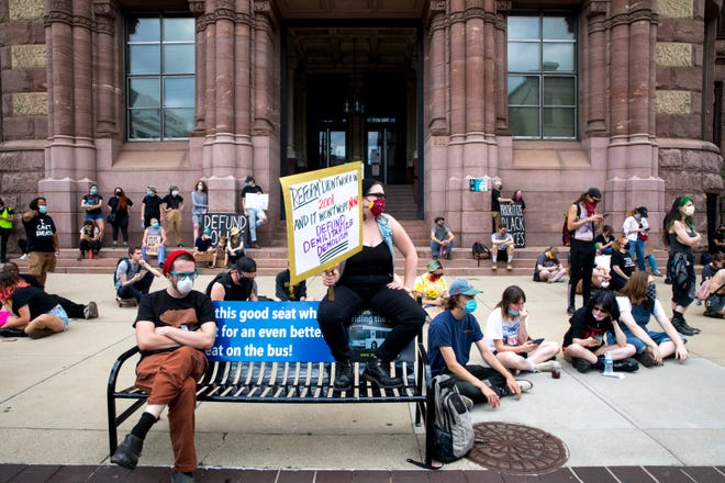 People protest, Monday, June 15, 2020, at City Hall in downtown Cincinnati. The protesters were organized by Mass Action for Black Liberation and protested the Cincinnati City budget asking the city council to defund the police and reinvest the money into the communities.