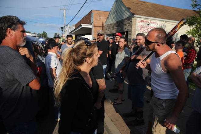 Counterprotesters confront demonstrators June 15 in Bethel, Ohio.