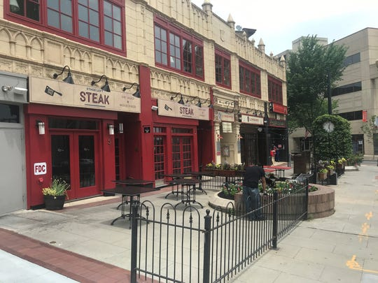 Stage Left Steakhouse and Catherine Lombardi set up for outdoor dinner service on June 15.
