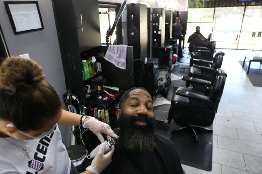 Rodrick Byrd, 56, of Canton has his beard trimmed by Crystal Combs, owner of Exposed Barbershop on Monday, June 15, 2020. Exposed Barbershop, located at the corner of West Eleven Mile Road and Greenfield Road in Southfield opened its doors for the first time in months after Coronavirus forced it to close. Even though personal care facilities are being allowed to reopen, strict requirements must be set in place before opening.