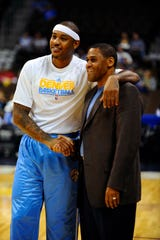 Nuggets small forward Carmelo Anthony shakes hands with his former coach and Thunder assistant general manager Troy Weaver before the game at the Pepsi Center on Oct. 19, 2010, in Denver.
