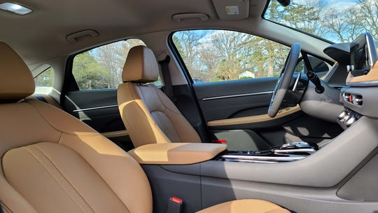 The interior of the 2020 Hyundai Sonata Hybrid Limited includes comfortable tan leather seats. But no sunroof as the ceiling is taken up by solar panels.