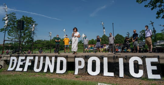"""Alondra Cano, a City Council member, speaks during """"The Path Forward"""" meeting at Powderhorn Park on June 7 in Minneapolis. The focus of the meeting was the defunding of the Minneapolis Police Department."""