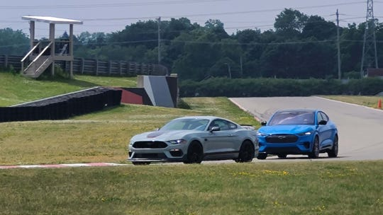 The 2021 Ford Mustang Mach 1 (left) is timed with the Mustang Mach E, the first electric Mustang SUV.