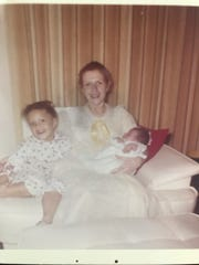 Winifred Hayes and her daughters; Janice sitting to her left and Jennifer, in her arms.