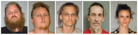 This combination of undated booking photos from the Shenandoah County (Virginia) Sheriff's Office shows from left to right, Donny Salyers, Dennis Salyers, Farrah Salyers, Christopher Sharp and Amanda Salyers. The group are being held without bond and face hate crime and assault charges after an altercation with a black pastor in Edinburg, Va., this month.