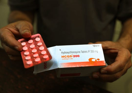 A chemist displays hydroxychloroquine tablets in New Delhi, India.
