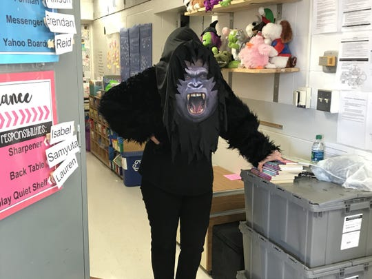 Marion Ginopolis, superintendent of Lake Orion Community Schools, wears a gorilla costume to read to elementary students as part of a special reading event in the district last school year.