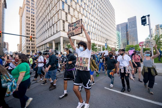 Demonstrators march down Woodward in Detroit on Sunday, the 17th day of protesting racism, police brutality and the death of George Floyd.