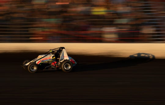 Donny Brackett of Fort Branch, Ind., competes with his 4B sprint car to finish first in his heat at Tri-State Raceway in Haubstadt, Ind., June 14, 2020. Brackett finished 11th in the feature race. Opening night was supposed to have been April 18, but this was the first race of the season since the coronavirus pandemic began.