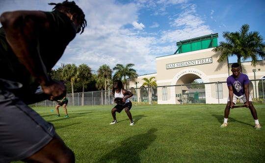 Members of the Fort Myers High School football team workout on Monday June, 15, 2020. It was the first day of summer workouts for public schools after being off because of the COVID-19 pandemic. Some private schools started workouts at the beginning of June.
