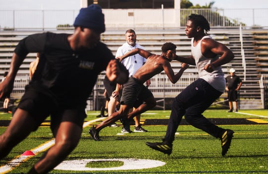 Members of the Bishop Verot High School football team workout on Monday June, 15, 2020. They are in phase two of of summer workouts. They started summer workouts on the first week of June. Public schools started summer workouts on Monday June 15.