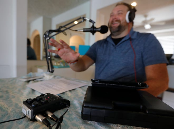 """""""We all need a reason to laugh,"""" said Cory O'Donnell, shown recording an episode of  """"Florida Freakshow"""" podcast. """"It's been a stressful time so anything we can do for a chuckle is good. The world is a weird, serious, uncomfortable place right now. This helps us bring some levity."""""""