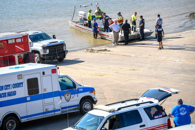 Rescue workers return to the Henderson riverfront Monday evening, after a three day search to locate a man who had been missing since Saturday evening, June 15, 2020.