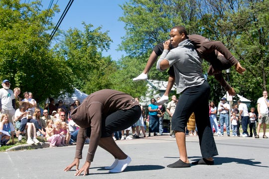 Kenny Johnson, front, Stephen Williams, and Nathan Darling, being lifted, of Madear's Kids, a professional youth dance troup from Gainsville, Fla,. perform for the crowd at the Southside Community Center's Juneteenth celebration in 2007 in Ithaca.