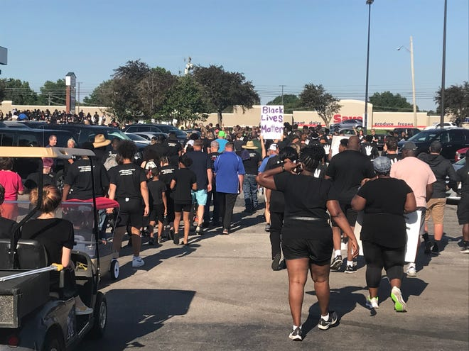 Marchers leave their starting point at the old Walmart building just south of Downtown Milan on Sunday afternoon. The walk to First Assembly Milan was about 2 miles.