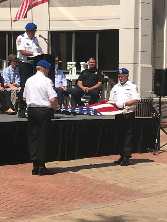 Members of the Vietnam Veterans Post 995 Honor Guard fold the American flag during the Flag Day ceremony on Sunday.