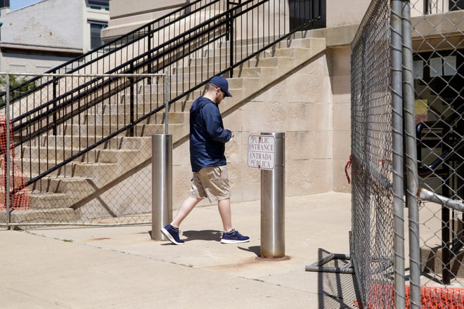 Fencing that surrounds the Tippecanoe County Courthouse is parted at the public entrance on Columbia Street, Monday, June 15, 2020 in Lafayette.