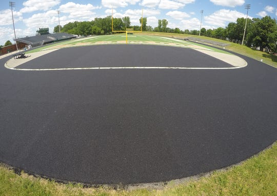 Howell High School's John Dukes Field, shown Monday, June 15, 2020, is getting a new track installed.