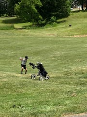 Alex Yancy hits a shot into the ninth hole at the Golf Club of Bucyrus Monday in a Heart of Ohio Junior Golf Association event.