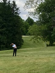 Tara Murphy chips onto the 18th green during Monday's Heart of Ohio Junior Golf Association stop at the Golf Club of Bucyrus.