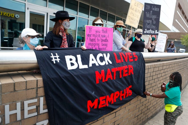 Demonstrators join with Black Lives Matter Memphis to hold a press conference on the jail steps at 201 Poplar demanding social justice and economic changes in Memphis on Monday, June 15, 2020. A forthcoming court order is expected to set new ground rules that limit city of Memphis government surveillance on protest groups like this.