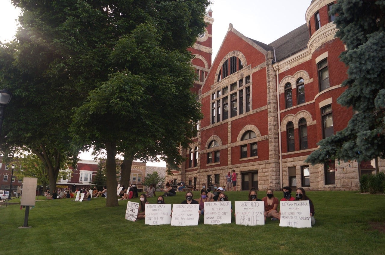 About 80 protesters sat quietly on the south side of the Historic Green County Courthouse June 5. The protest, a continuation of the national movement in wake of the police killing of George Floyd, a black man, was started by a pair of Monroe High School juniors that had hoped for a turnout of 15 people.