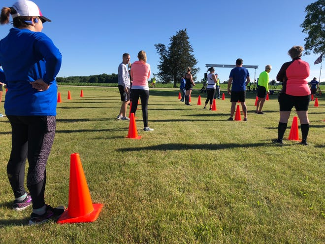 Cones marked the staring spots for runners, 10 feet apart, for a race in June. Most racing events this summer have been canceled or gone virtual.