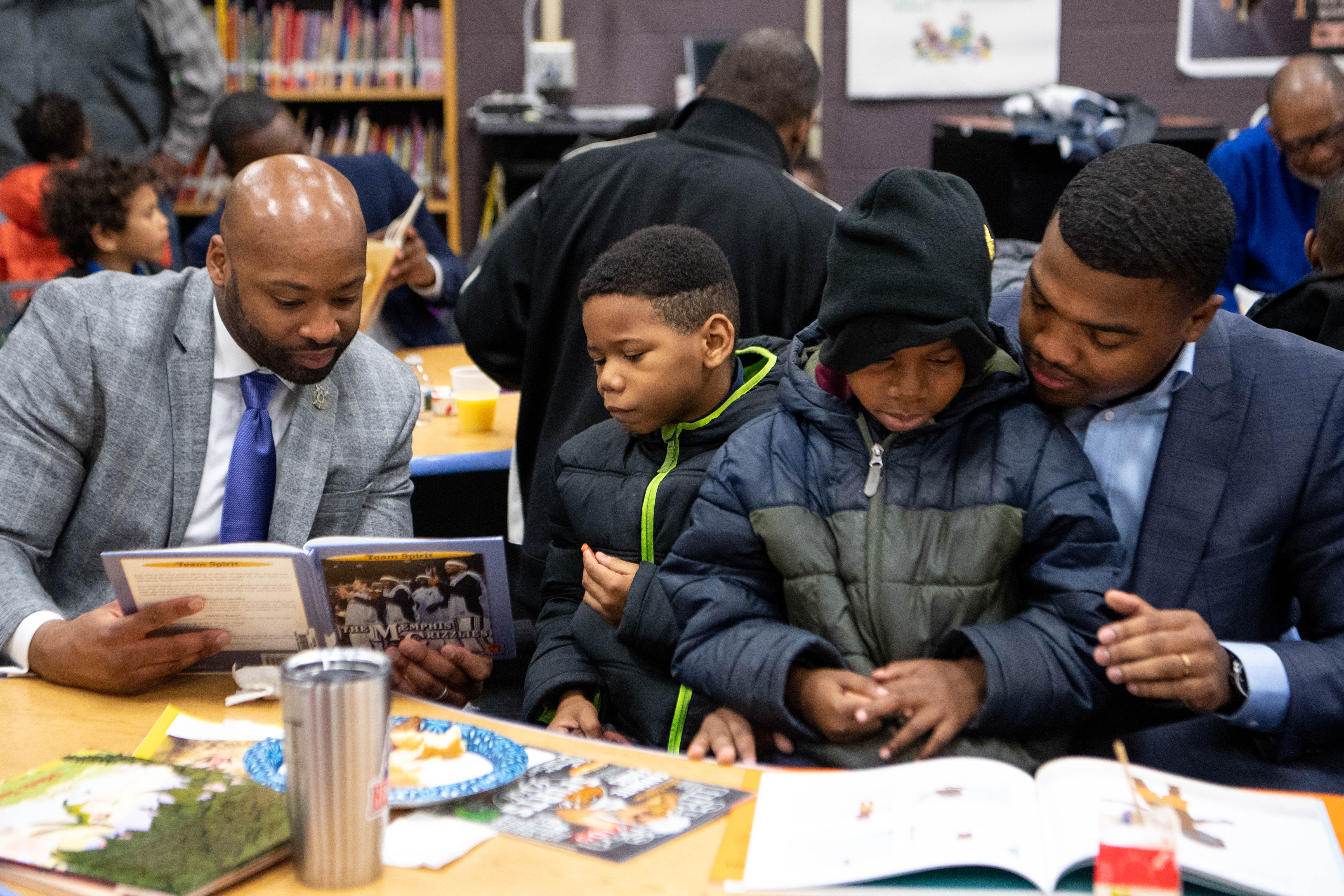 Xavier Purdy, from left, Tyrell Kirkwood, Tykese Kirkwood-Welch and Dameion Cowans read together during Fatherhood Friday at Buena Vista Elementary on Dec. 13, 2019, in Nashville, Tenn.