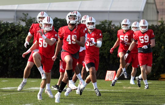 Wisconsin players don't know yet when they'll get on the field, but on Monday they were allowed to work out in small groups with strict safety rules.