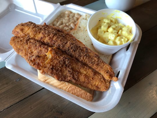 Bee Hive Bistro's fried catfish is served on white bread, alongside home-style potato salad and white beans.