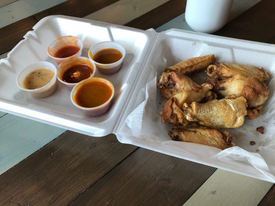 Wings from Bee Hive Bistro feature nearly a dozen sauces, including spicy seasoned, lemon pepper, garlic Parmesan, honey gold, honey hot, honey hot, buffalo and bee sting.