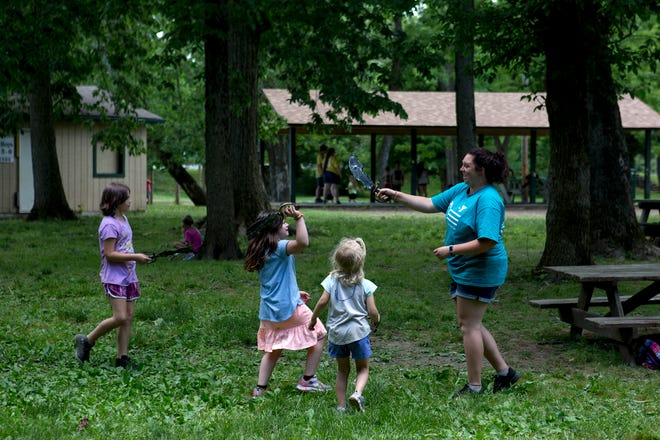 YMCA counselor Mary Pound has a sword fight with her campers. Pound had pirate day with the kids and they all created swords. Camp is in session and abiding by social distancing guidelines by having smaller camp groups and less children attending daily.
