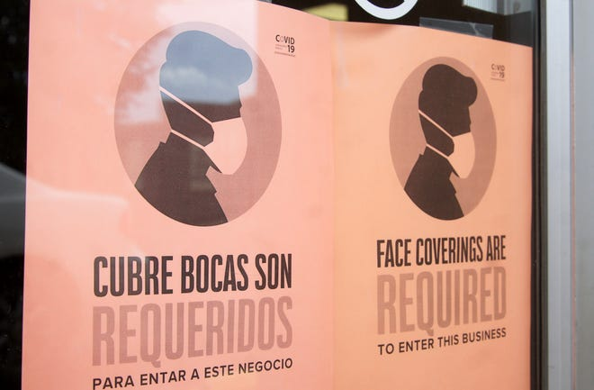 Businesses in downtown Deming remind customers of the New Mexico health order to wear a mask in public.