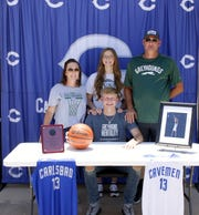 Riley Hestand along with his mother, sister and father on June 15, 2020. Hestand accepted a walk-on opportunity for the Eastern New Mexico University basketball team next season after spending three years on Carlsbad's varsity squad.