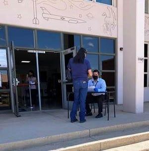 Prospective juror enters the Otero County Courthouse in Alamogordo
