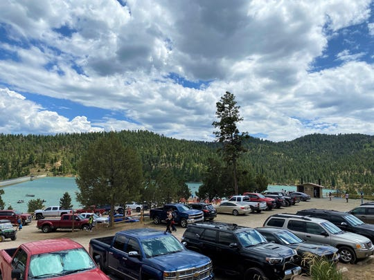 Vehicles filled the parking area at Grindstone Lake on June 13