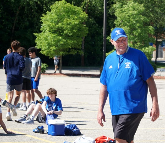 Detroit Catholic Central head football coach Dan Anderson smiles as he talks to players during a June 15, 2020 preseason workout at their Novi campus.